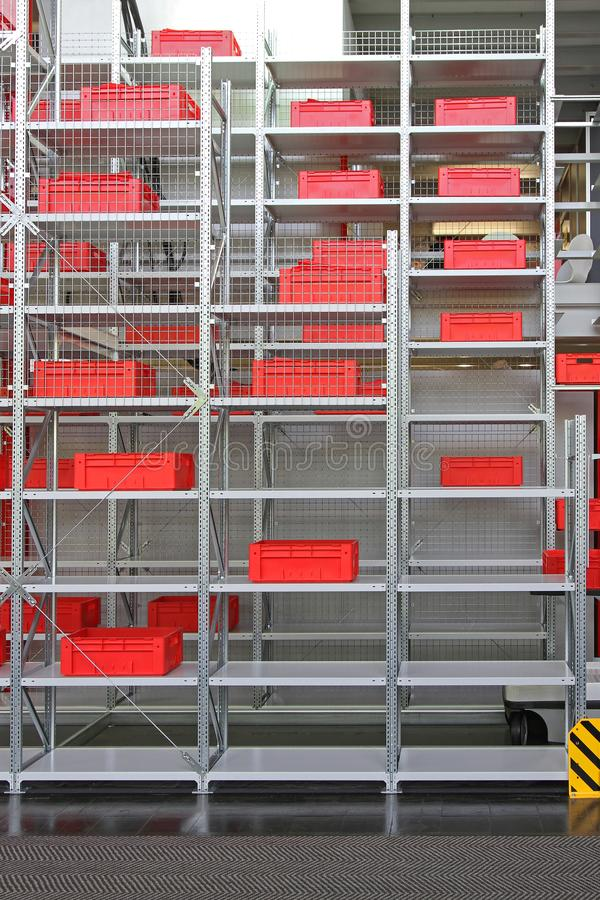 Shelving System Warehouse. Red Crates and Boxes at Shelf in Distribution Warehouse royalty free stock photography