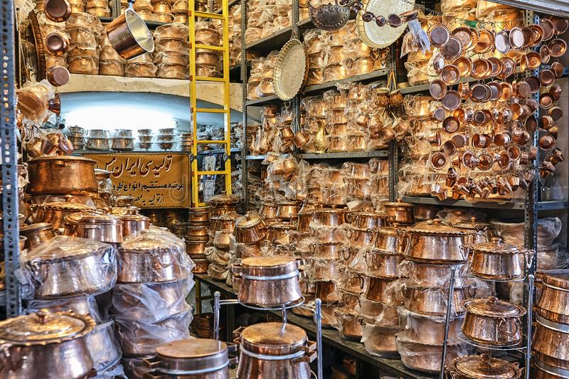 shelvings with copper and brass utensils, cookware shop