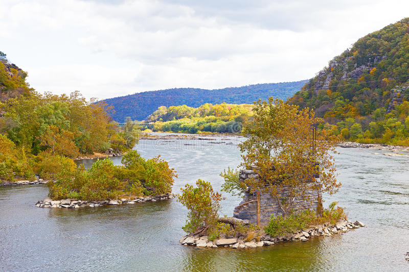 Shenandoah River and Potomac River meet each other near Harpers Ferry historic town. Old bridge bearings in the water in autumn, Harpers Ferry, West Virginia royalty free stock images