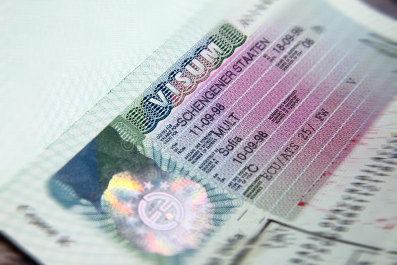 Shengen visa stamp in international passport. Schengen document for pass customs control on border of a country. Document for trav stock images