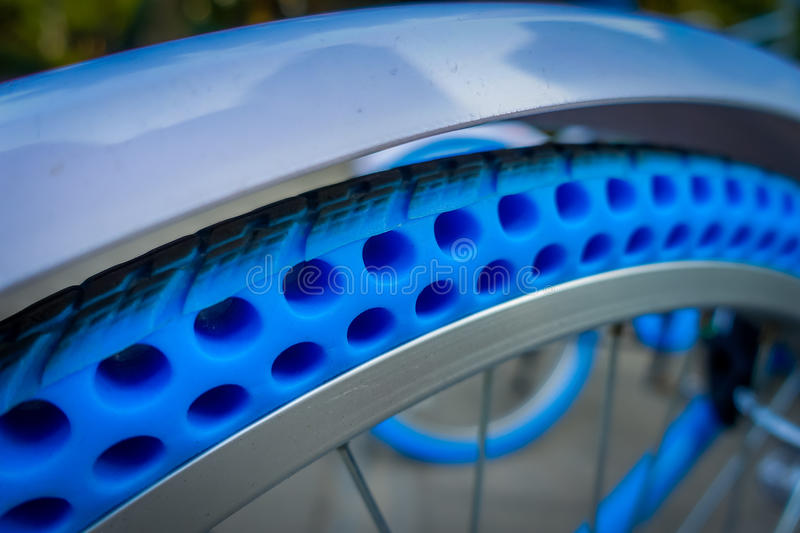 SHENZEN, CHINA - 29 JANUARY, 2017: Close up plastic wheel of inner city bicycle, modern bike tire technology for extra. Durability stock photography