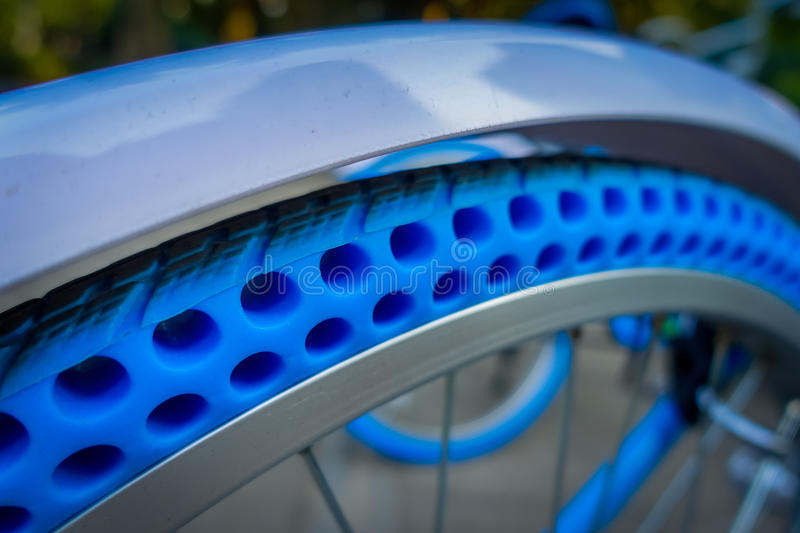 SHENZEN, CHINA - 29 JANUARY, 2017: Close up plastic wheel of inner city bicycle, modern bike tire technology for extra. Durability royalty free stock photo