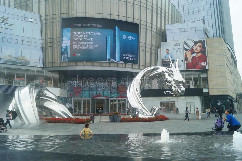 Shenzhen, China: adults and children play around the fountain in the shopping mall. In the morning, Yi Fang Cheng shopping mall fountain pool, adults and stock photography