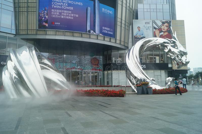 Shenzhen, China: adults and children play around the fountain in the shopping mall. In the morning, Yi Fang Cheng shopping mall fountain pool, adults and royalty free stock images