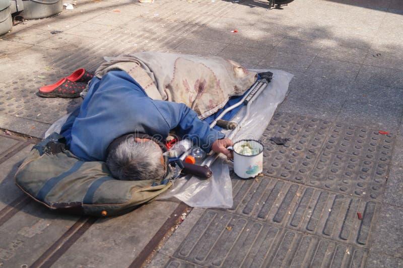 Shenzhen, China: bedelaars stock foto