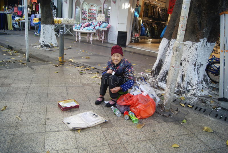 Shenzhen, china: begging. Shenzhen Baoan Xixiang commercial pedestrian street, an old woman begging royalty free stock photos