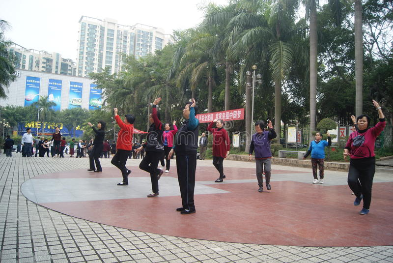 Shenzhen, China: citizens in jump square dance stock photo