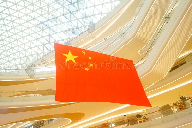 Shenzhen, China: a giant five-star red flag hangs in a shopping mall to greet National Day royalty free stock images