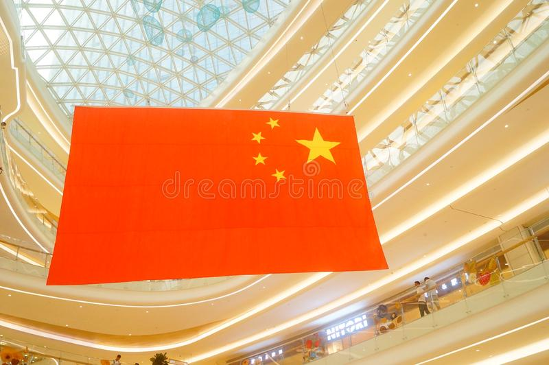 Shenzhen, China: a giant five-star red flag hangs in a shopping mall to greet National Day royalty free stock image