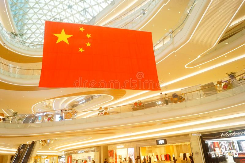 Shenzhen, China: a giant five-star red flag hangs in a shopping mall to greet National Day royalty free stock photos