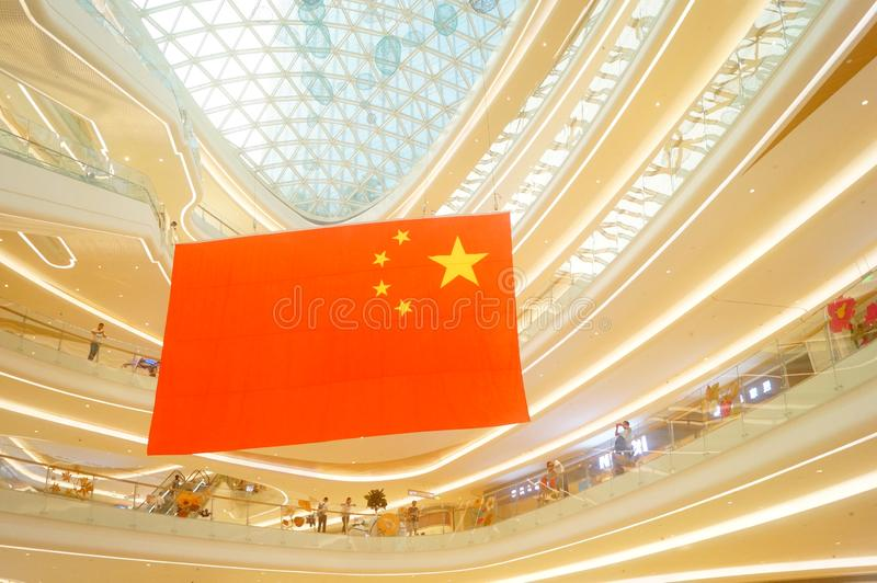 Shenzhen, China: a giant five-star red flag hangs in a shopping mall to greet National Day stock photo
