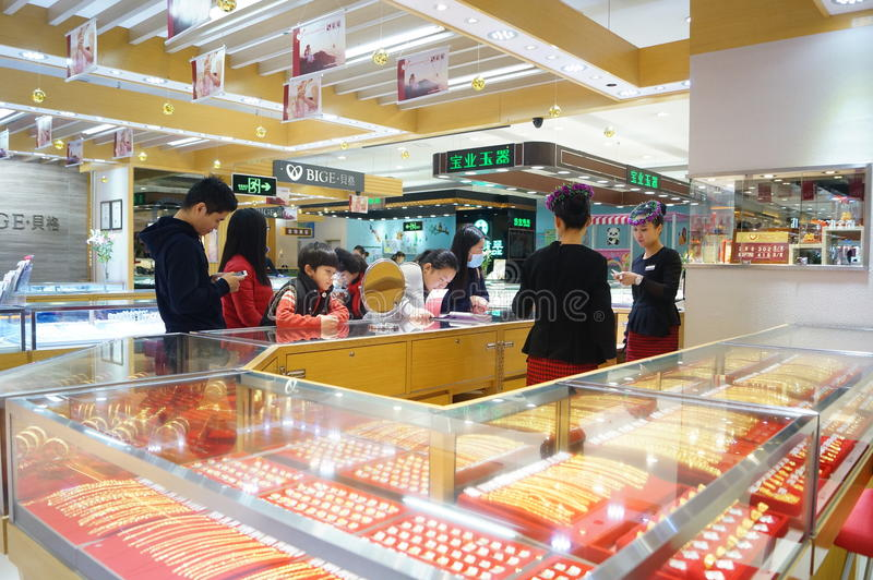 Shenzhen, China: gold jewelry counter. Shenzhen Baoan Tian Hong shopping center, gold jewelry counter, at the March 8th International Women's day, Business royalty free stock photos
