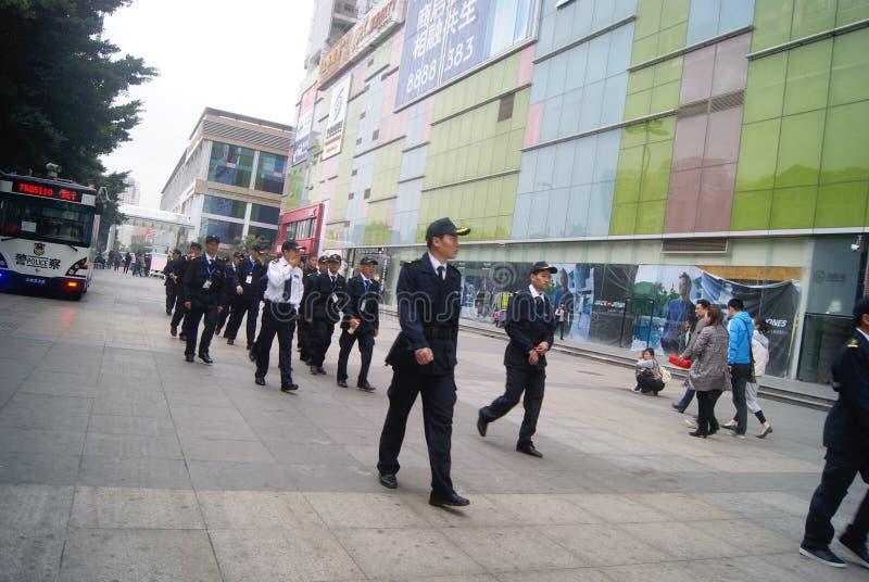 Shenzhen, China: guardias de seguridad fotos de archivo