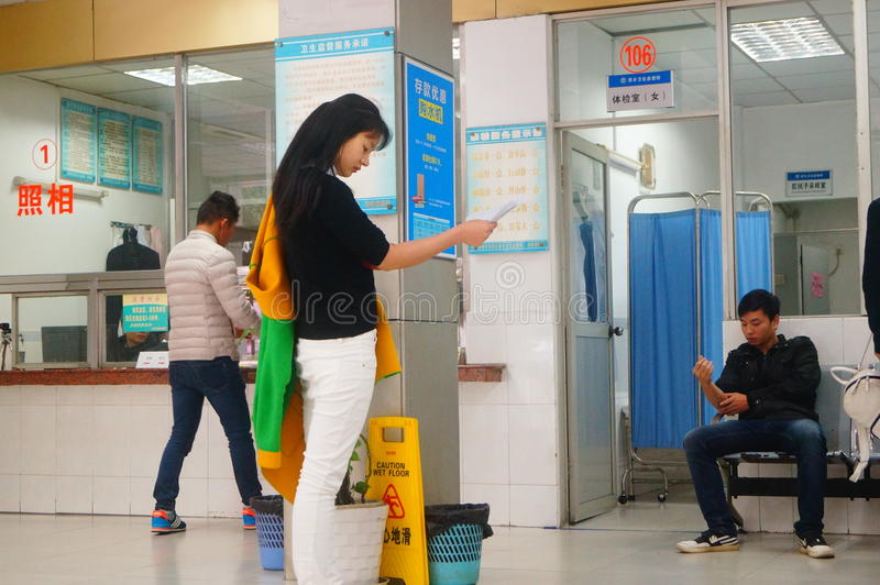 Shenzhen, China: health and epidemic prevention station room, workers are doing physical examination. Baoan Xixiang health and epidemic prevention station, to royalty free stock photos