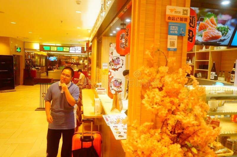 Shenzhen, China: het restaurant is in het ondergrondse winkelcomplex dichtbij de metropost stock afbeelding
