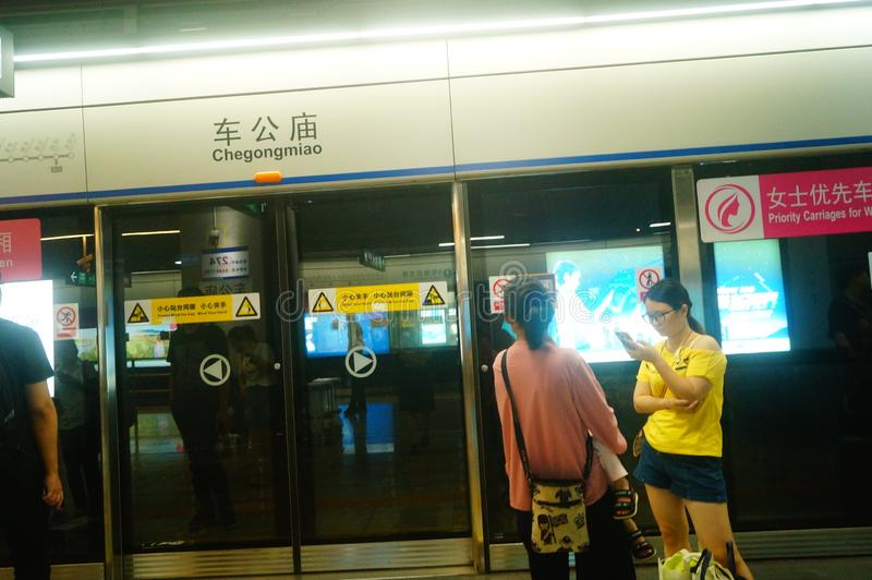 Shenzhen, China: landscape of Che Kung Temple subway station, male and female passengers. The scenery of Che Kung Miao subway station in Shenzhen, male and stock photo