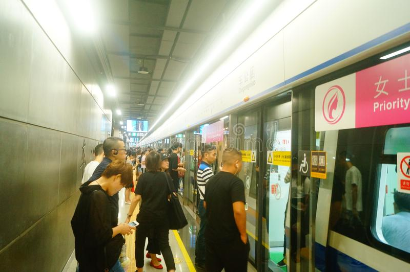 Shenzhen, China: landscape of Che Kung Temple subway station, male and female passengers. The scenery of Che Kung Miao subway station in Shenzhen, male and stock images
