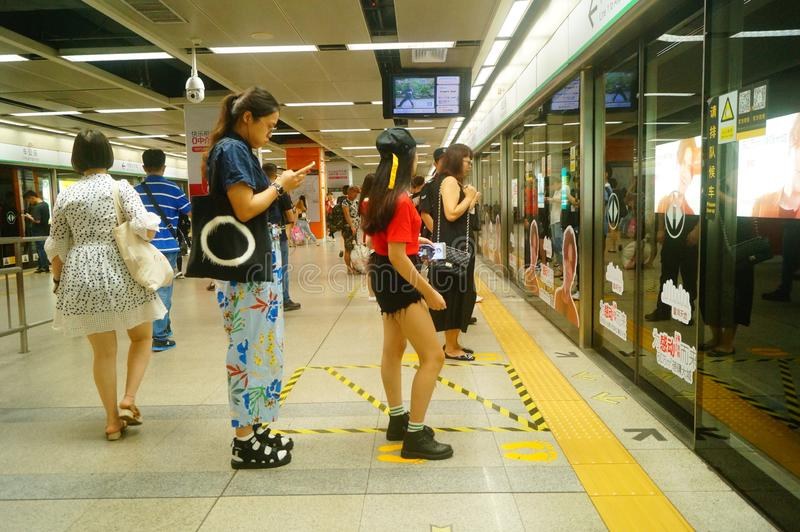 Shenzhen, China: landscape of Che Kung Temple subway station, male and female passengers. The scenery of Che Kung Miao subway station in Shenzhen, male and stock photos
