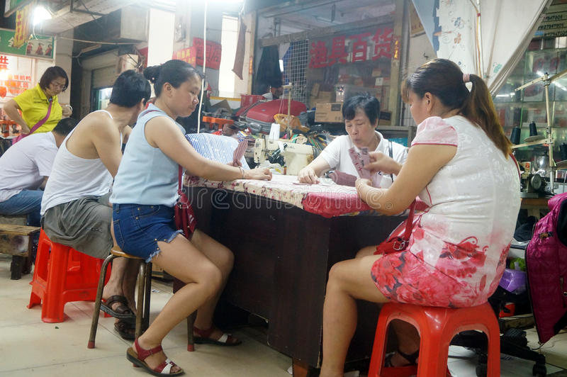 Shenzhen, China: market vendors play cards at noon. At noon, Xixiang market traders are playing cards, in Shenzhen, china stock photography