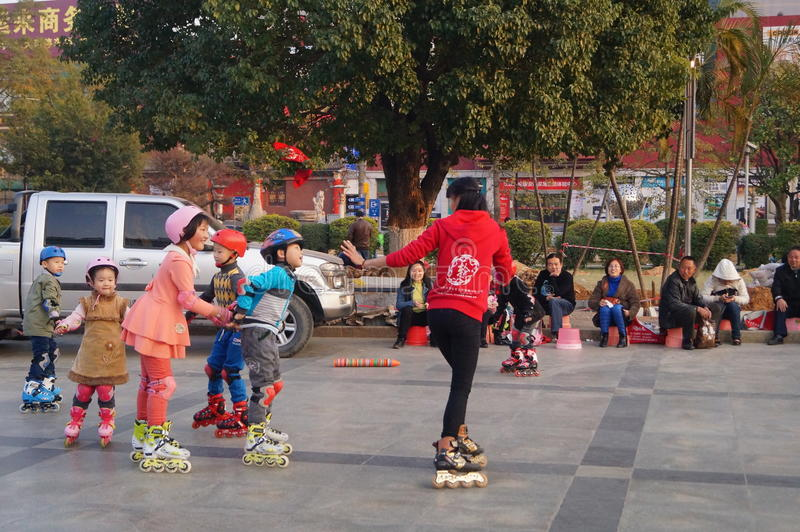 Shenzhen, China: outdoor skating. Shenzhen Baoan Xixiang, outdoor plaza, a little girl and her teacher in skating. This is the recreational sports, people like stock images