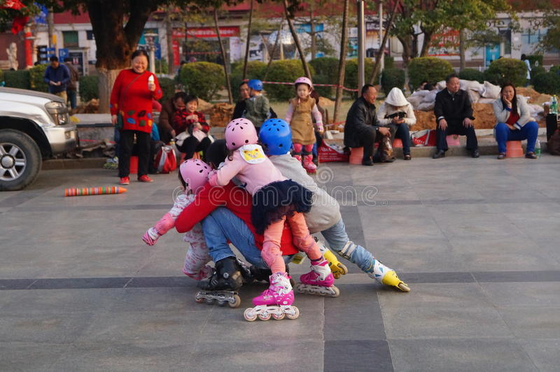 Shenzhen, China: outdoor skating. Shenzhen Baoan Xixiang, outdoor plaza, a little girl and her teacher in skating. This is the recreational sports, people like royalty free stock photos