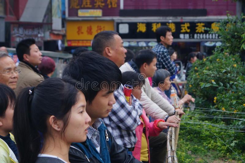 Shenzhen, China: people with disabilities in the singing and begging. Shenzhen Baoan Xixiang, persons with disabilities in the singing and begging. Citizens are stock photos