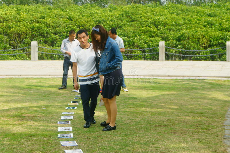 Shenzhen, China: photos of birds, on the lawn, are given away free to tourists. Photos taken by a photographer at the Shenzhen Bay Park on the lawn, if you like stock photos