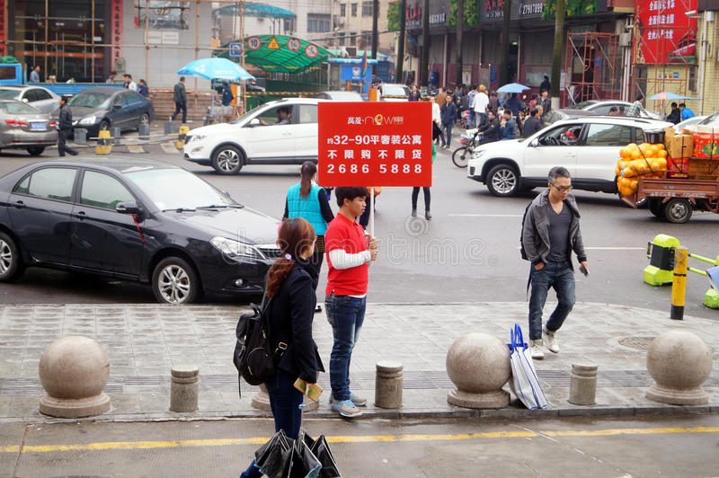 Shenzhen, China: real estate salesman in selling a house royalty free stock image