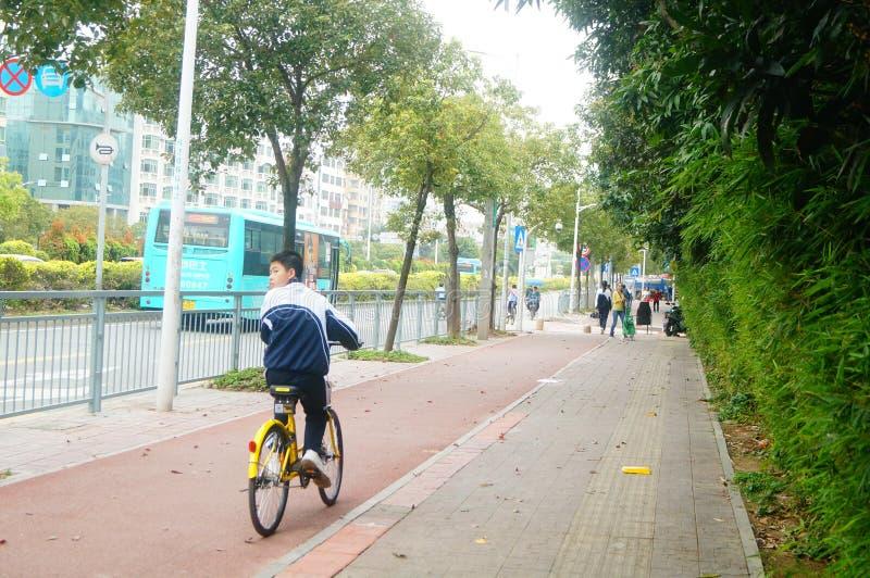 Shenzhen, China: students go to school by bike. Students go to school by bike in Shenzhen, china stock image