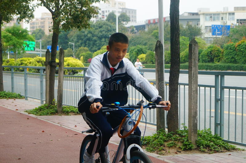 Shenzhen, China: students go to school by bike. Students go to school by bike in Shenzhen, china royalty free stock photo