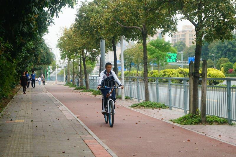 Shenzhen, China: students go to school by bike. Students go to school by bike in Shenzhen, china royalty free stock photos