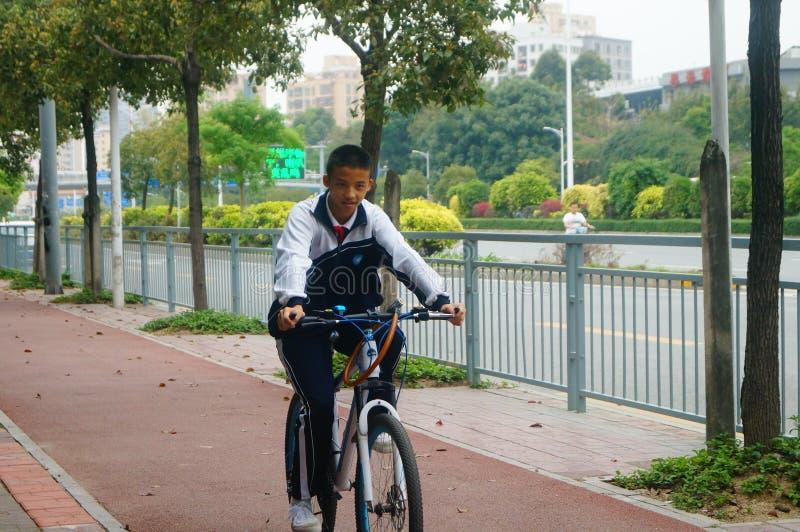 Shenzhen, China: students go to school by bike. Students go to school by bike in Shenzhen, china stock photos