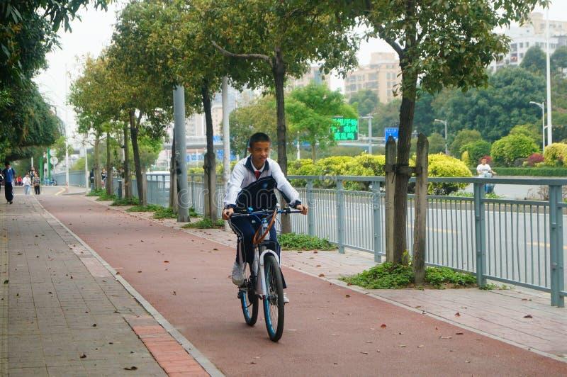 Shenzhen, China: students go to school by bike. Students go to school by bike in Shenzhen, china stock photography