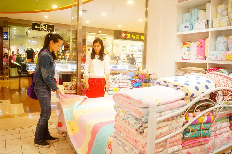 Shenzhen, China: women are buying bedding and other bedding royalty free stock photo