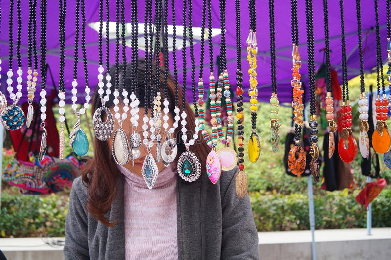 Shenzhen, China: women jewelry. Shenzhen Baoan Shopping Festival shows sales of women jewelry, these crafts products, China Miao a hairpin, rings, bags and so on stock photos