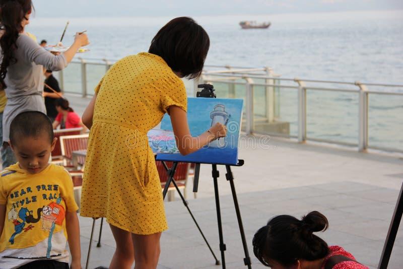 Shenzhen, Cina, il disegno di una donna immagini stock