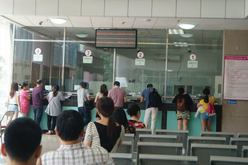 Shenzhen Kina: befolkning och familjeplaneringstation royaltyfria bilder