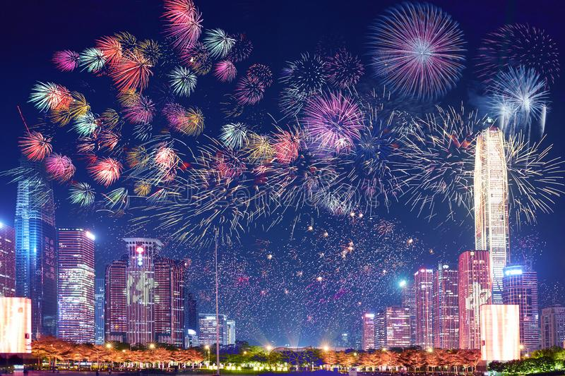 Shenzhen skyline fireworks, Guangdong, China. Panorama of Shenzhen city night view with light and firework show on modern building wall celebrating Chinese new royalty free stock photography