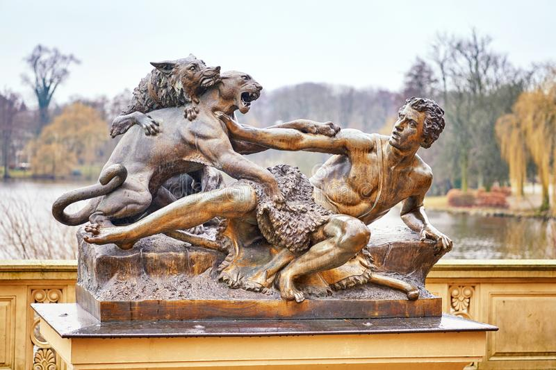 Shepherd and dog attacked by a panther. Sculpture in Schwerin Mecklenburg-Vorpommern stock images
