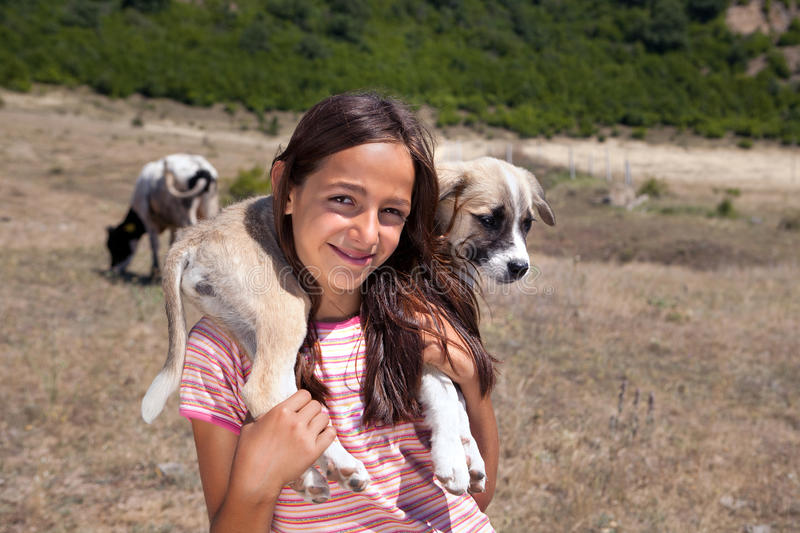 Shepherd Girl With Puppy Royalty Free Stock Image