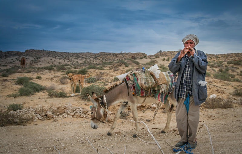 Shepherd playing flute royalty free stock images