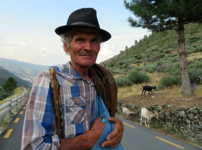 A shepherd on the road in the mountains of Serra da Estrela Natural Park taking cheese out of his bag royalty free stock photos