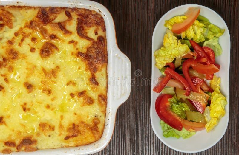 Shepherd`s pie or cottage pie with fresh salad stock photos