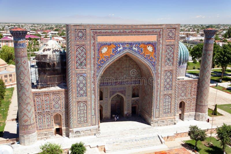 Sher Dor Medressa - Registan - Самарканд - Узбекистан стоковые фото