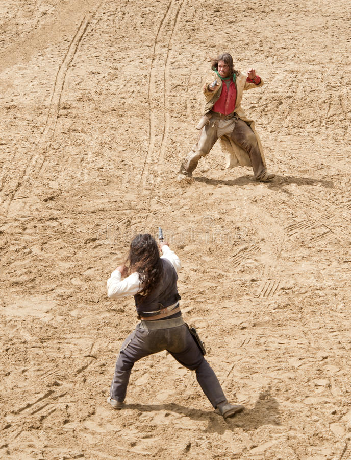 Sheriff and Bandit gunfight. At Mini Hollywood, Almeria, Andalusia Spain royalty free stock images
