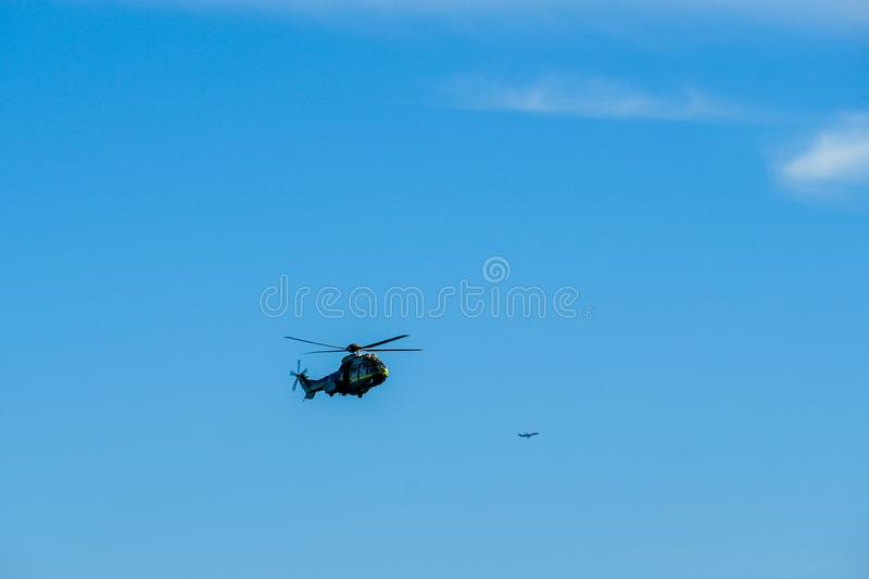 Sheriff Helicopter Hovering on a Beautiful Sky Background. Sheriff Department helicopter on a routine surveillance mission in Santa Monica. Los Angeles royalty free stock photography