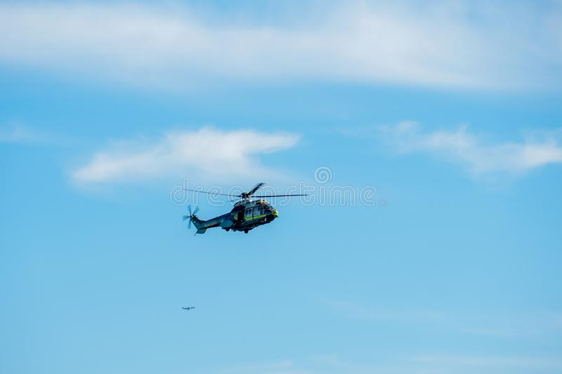 Sheriff Helicopter Hovering on a Beautiful Sky Background. Sheriff Department helicopter on a routine surveillance mission in Santa Monica. Los Angeles royalty free stock photos