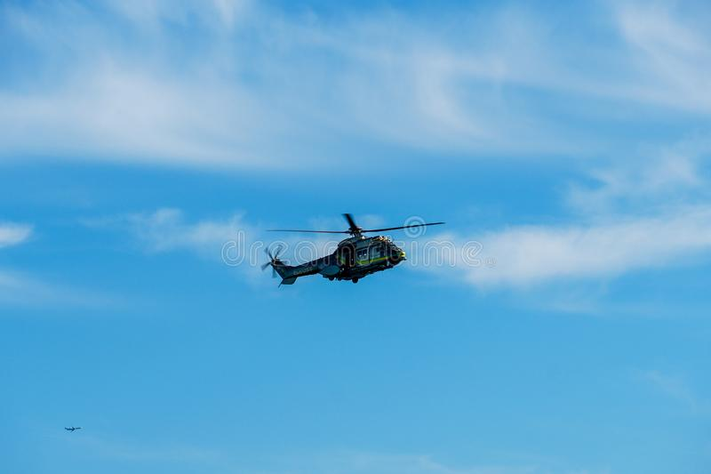 Sheriff Helicopter Hovering on a Beautiful Sky Background. Sheriff Department helicopter on a routine surveillance mission in Santa Monica. Los Angeles stock photography