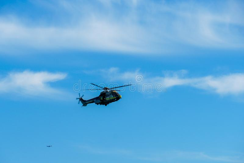 Sheriff Helicopter Hovering on a Beautiful Sky Background. Sheriff Department helicopter on a routine surveillance mission in Santa Monica. Los Angeles stock photos