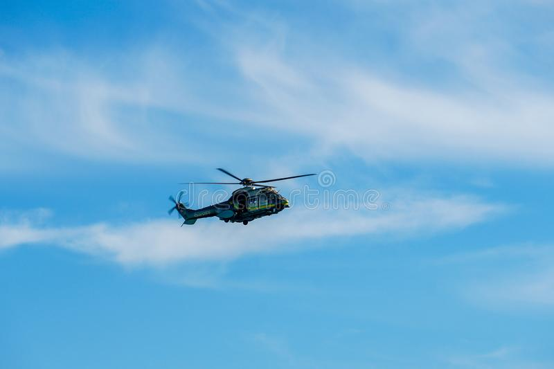 Sheriff Helicopter Hovering on a Beautiful Sky Background. Sheriff Department helicopter on a routine surveillance mission in Santa Monica. Los Angeles stock photo